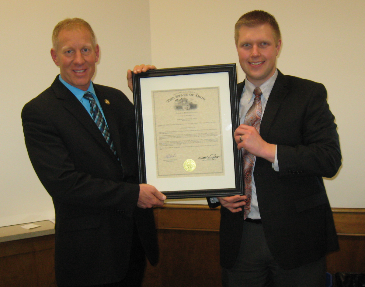 Mayor Walters and Finance Director Bryan Hoffman holding Certificate of Achievement for Excellence in Financial Reporting.